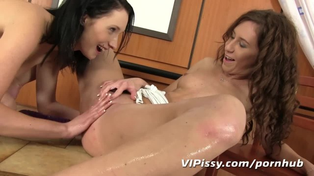 Pissing Lesbian Babes get Soaked in their first Time Pee Play