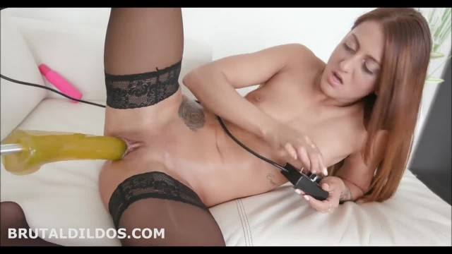Babe taking a Huge Yellow Brutal Dildo on a Fucking Machine at High Speeds