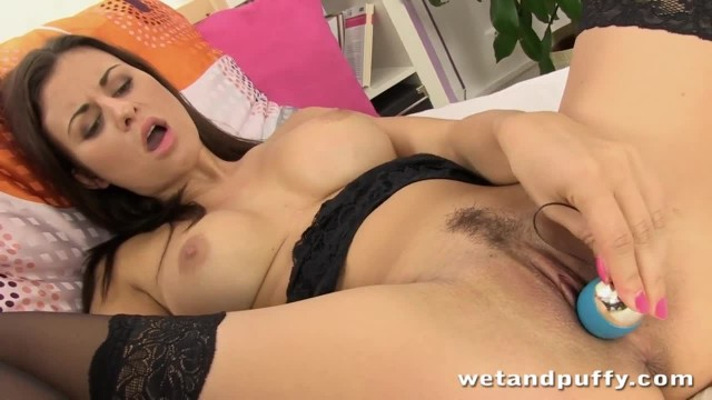 Sexy Lady Dressed in Black Teasing herself