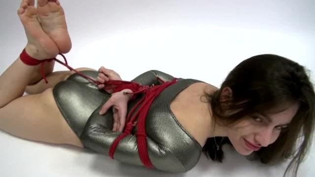Tied Cutie Struggling in Bondage