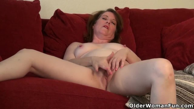 An Older Woman Stripping and Masturbating