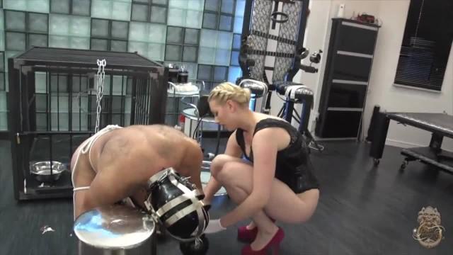 Mistress Elizabeth Garden Whipping her Chained Slave