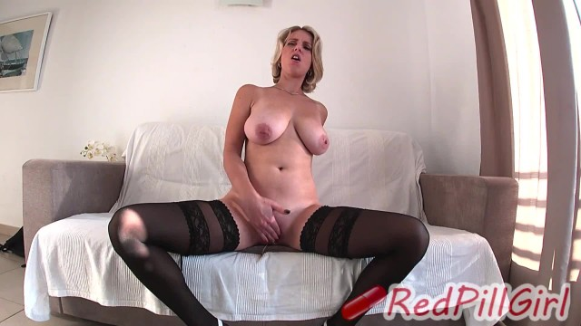 Blonde MILF in stockings with big natural tits masturbates on sofa
