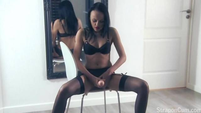 Hot brunette Angellina wears sexy lingerie while rubbing her strapon