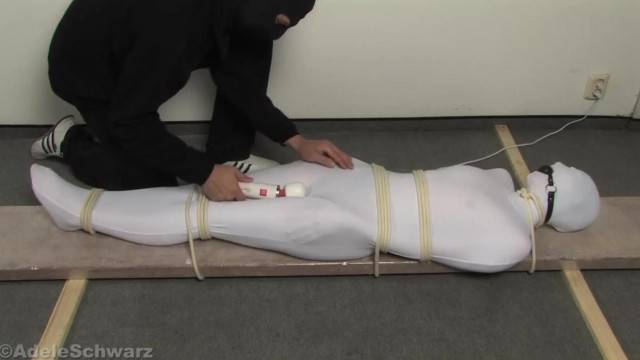 Immobilized slave toyed through clothes in amateur BDSM