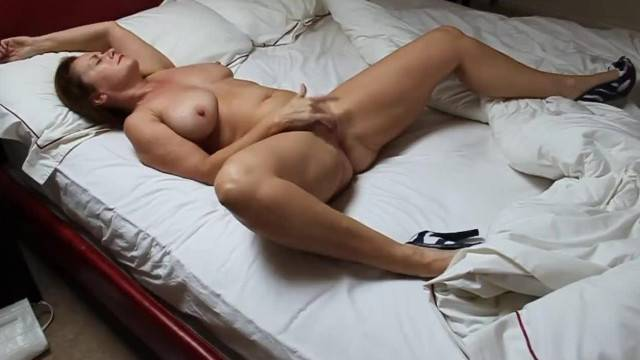 Curvy mature lady with big tits pleasures her horny twat