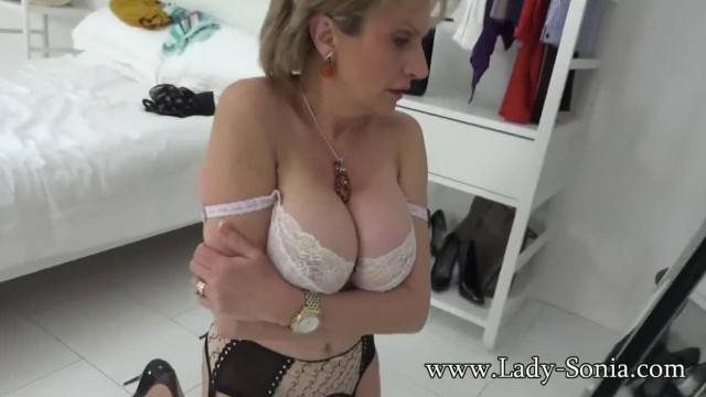 Kinky Lady Sonia teases with sexy lingerie and her natural big tits