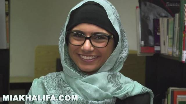 Famous Arab Beauty Mia Khalifa strips off in a library