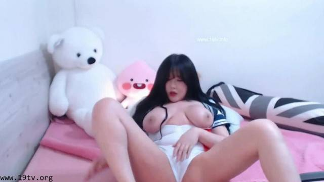 Busty cosplay camgirl fingers her pussy and cums hard