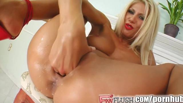 Fist Flush she Squirts Bucket Loads from her Pussy