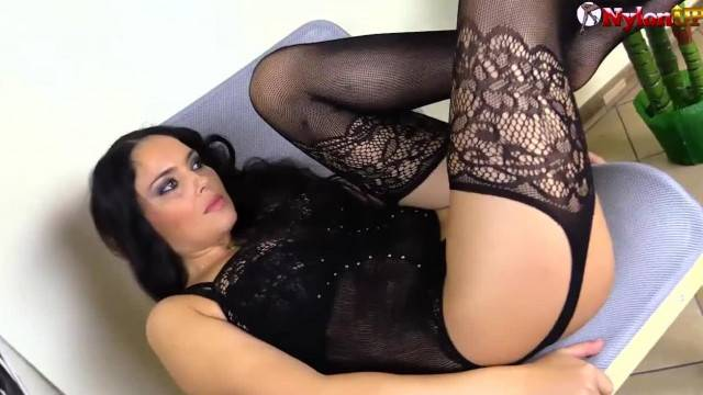 Gorgeous Brunette Strips and Tries Stockings