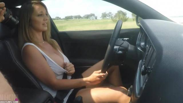 Nikki Sims Loves Flashing her Big Tits while Driving