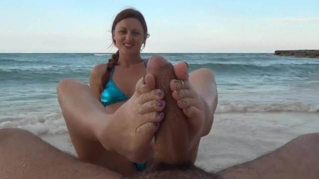 Sexy Teen Karlie giving Caribbean Beach Footjob