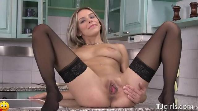 Hot Blonde Slut Spreads her Pussy