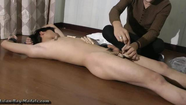 Asian boy toy gets a nice handjob in amateur BDSM
