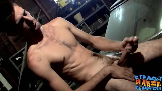 Jock guy rubs his hard cock in the garage