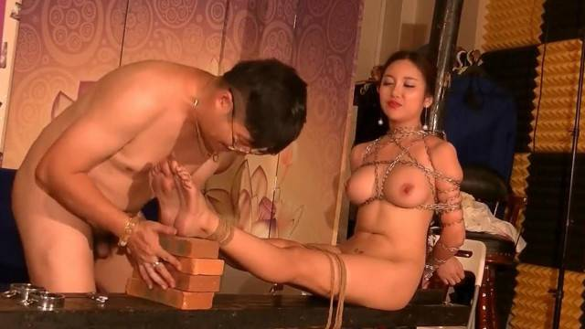 Asian BDSM photo shooting with hot busty model