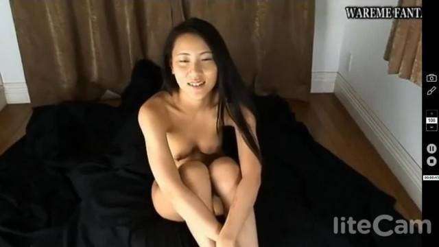 Asian beauty stretches her pussy for the camera