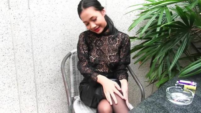 Young Girl teases with her Leather Skirt while Smoking