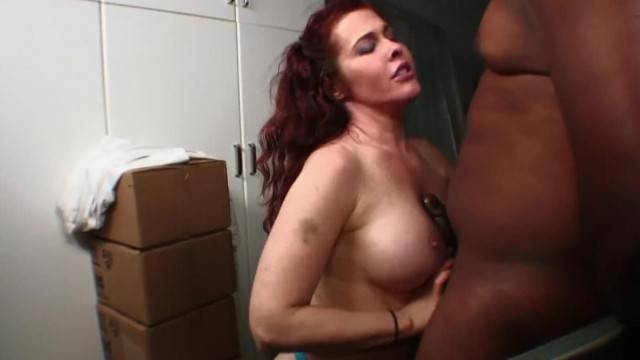 FUCKED AT WORK THE REDHEAD WITH HUGE TITS GETS HER BLACK DELIVERY IN REAR