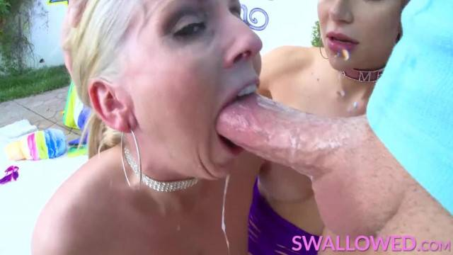 Two Stunning Busty Milfs Gagging on a Hard Cock