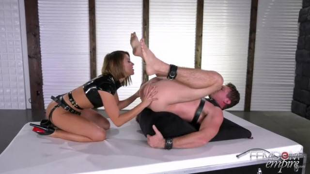 Dominatrix punishes her slave with a big dildo in his ass