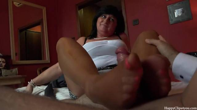 Young cock worked in footjob and handjob by mature lady