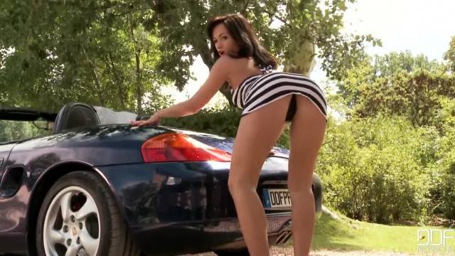 Tess Lyndon Rubs her perfect tits on a Porsche Boxster