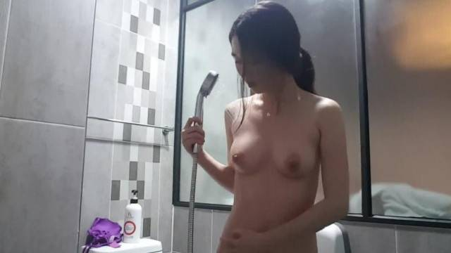 Amateur shower teasing with busty korean chick