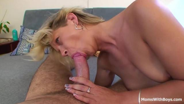 Blonde step mom plays with her son hard dick