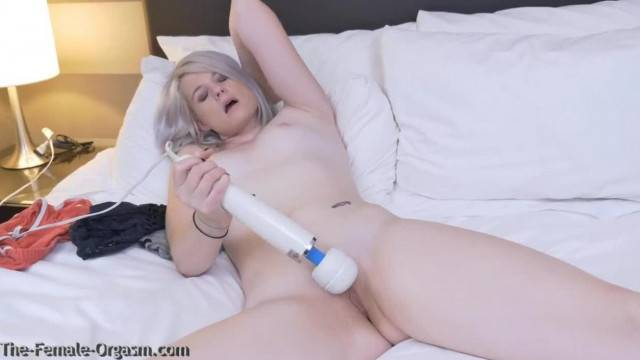 Cute blondie shakes her horny pussy with hitachi