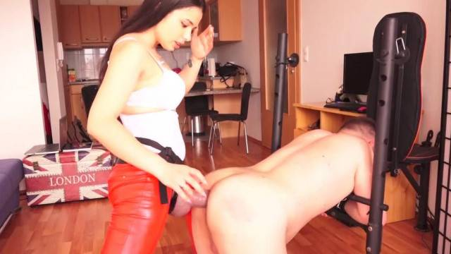 Cute mistress Mira gives harsh strap on punishment