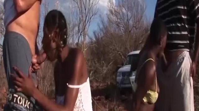 Ebony beauties tamed in outdoor amateur group fuck