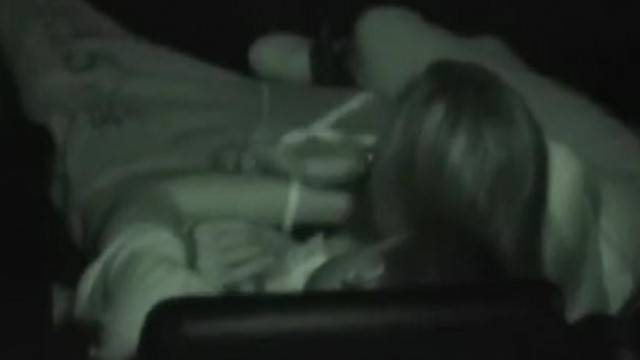 Girl giving a handjob and a blowjob to her boyfriend at the cinema