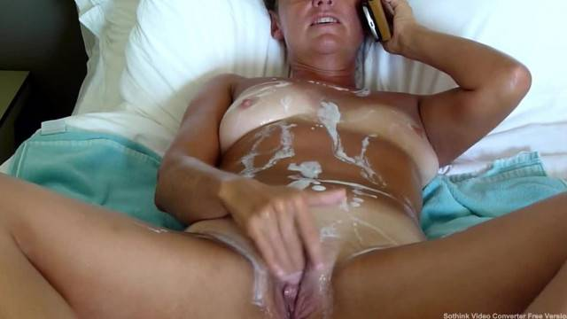 Horny mature wife rubs her clit while talking on phone