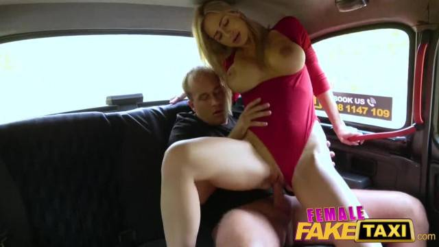 Horny blonde cab driver rides her client in the car