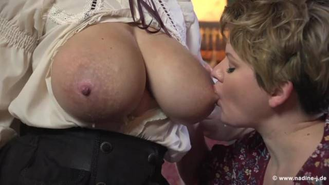 Lactating busty babes suck each other nipples