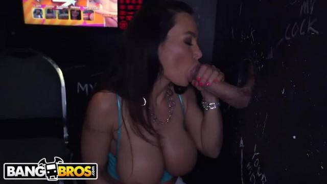 Busty MILF Lisa Ann blows and fucks fat cocks at glory hole