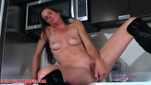 Brunette MILF goes naughty in the Kitchen