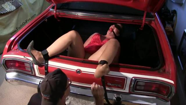 Slave tied up mouth gagged and tickled in the car trunk