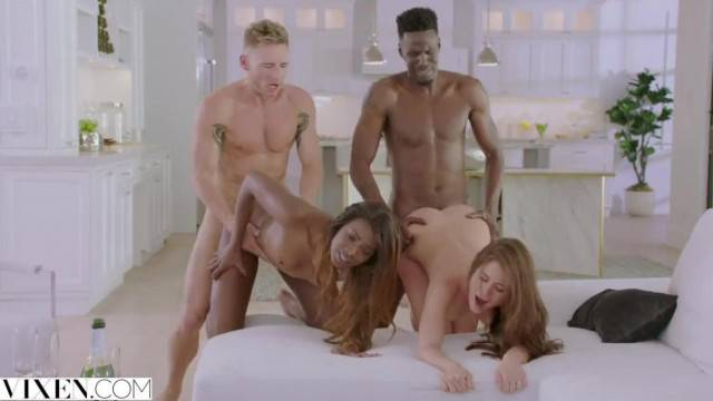 Naughty babes switch partners in interracial group fuck
