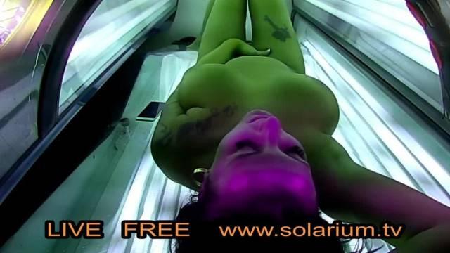 Big tits babe tanning at the solarium on voyeur spy cam