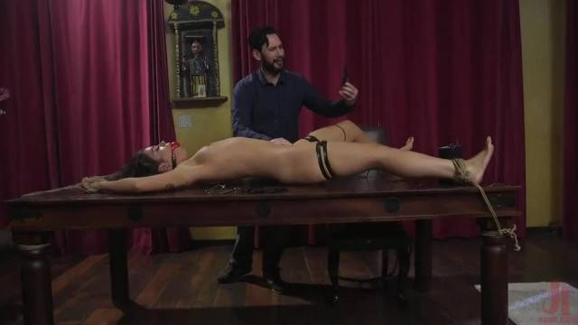 Tied up curly brunette gets anal torture in BDSM hostage fantasy