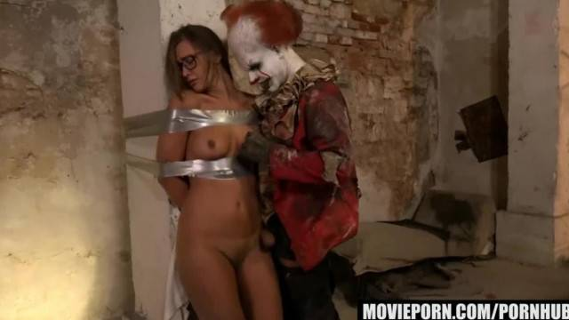 Immobilized babe Naomi Bennet fucked hard by the clown