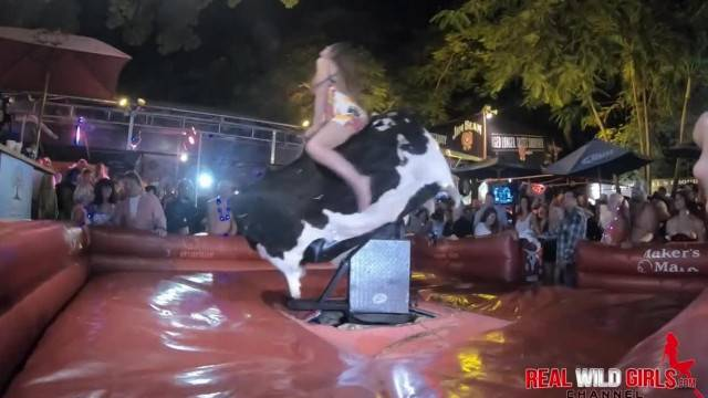 Bull riding competition with sexy adventurous babes